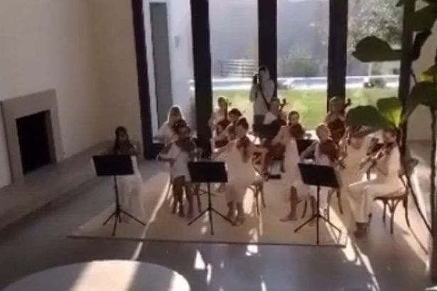 Kanye-West-wakes-Kim-Kardashian-with-a-string-orchestra-on-Mothers-Day